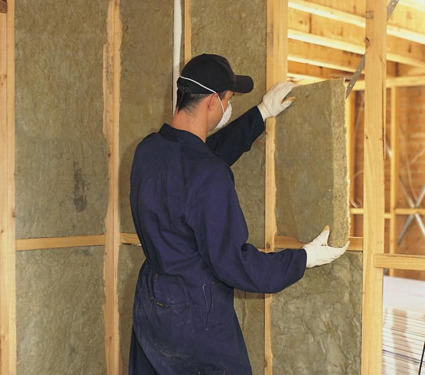 Installation of insulation for walls inside the house in the country