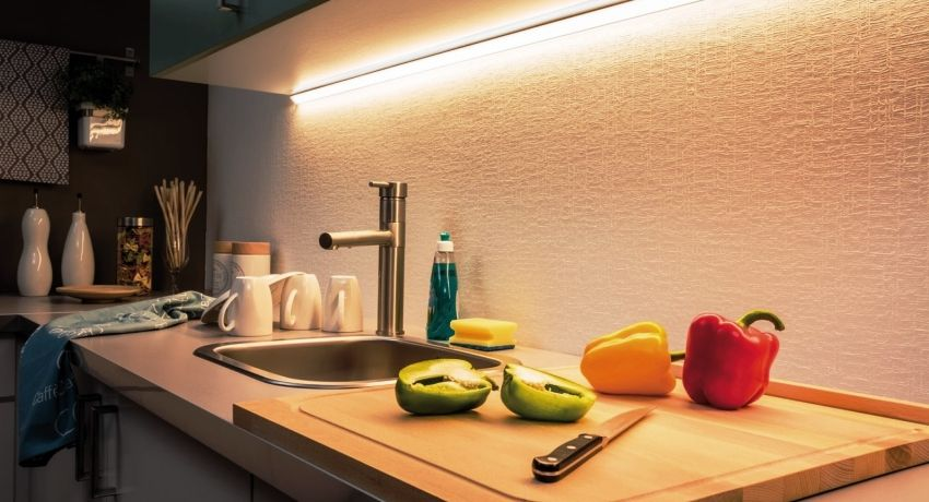 LED lighting for the kitchen under the cabinets: features of choice and installation