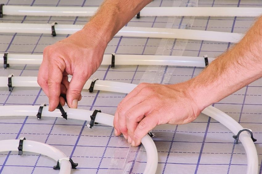 Laying underfloor heating under tiles: the technology of self-installation system